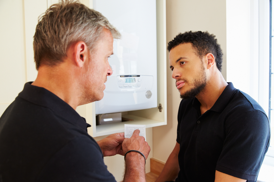 Gas boiler engineer and plumber fitting boilers